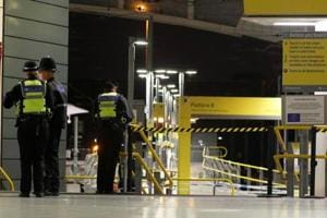 Police officers stand at the end of a tram platform following a stabbing at Victoria Station in Manchester, Britain on January 1.