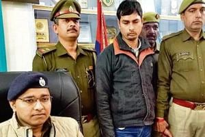 (Standing, second from left) Karamveer, a former lineman with NTPC, in police custody. He was fired in last July for alleged irregularities.