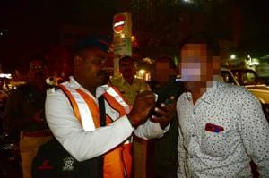 A traffic policeman uses a breath analyser to check drink driving at Nerul on Monday.