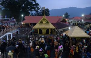 Devotees are pictured at the Lord Ayyappa temple in Sabarimala in Kerala on November 16.