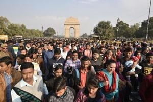 People gather at India Gate to celebrate the first day of the new year in New Delhi on Tuesday, January 1, 2019.  Despite heavy police deployment around C-hexagon, revellers began gathering around India Gate from afternoon and the numbers soared by evening.