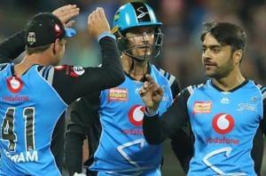 Adelaide Strikers' Rashid Khan (right) celebrates a wicket.