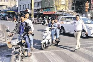 Police officials take action on helmetless riders at Lokmanya Tilak  chowk.
