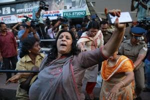 Police intervene as members of Sabarimala Karma Samithi try to disrupt a celebratory meeting after two women entered Sabarimala Ayyapa temple, at the High Court Junction in Kochi in the Indian state of Kerala on January 2, 2019