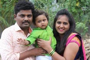 Atharva Barkade with his parents Ajit and Jyoti.
