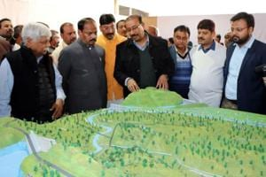 Chief minister Raghubar Das going through a model of Manal dam project while reviewing the preparation for the Prime Minister