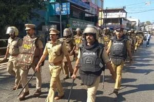 Police personnel carried out a march in trouble-torn Thalassery in Kannur district on Saturday after widespread violence rocked the area. Houses of an MP, MLA and many party leaders (both RSS and CPI(M)) were attacked in the latest bout of violence fuelled by unrest in Sabarimala.