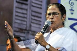 West Bengal Chief Minister Mamata Banerjee addresses the gathering during the inauguration of Goddess Kali Puja, ahead Kali Puja festival in Kolkata.