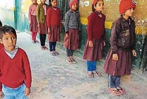 Students without shoes at primary school in Nagla Rambal in Agra.