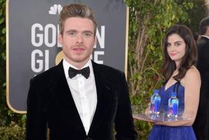 """Twitter has been buzzing with pictures of """"water girl"""" photobombing stars on the Golden Globes red carpet."""