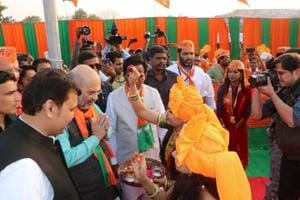BJP party workers welcome party chief Amit Shah in Latur.
