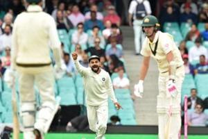 India skipper Virat Kohli celebrates the fall of a Australia wicket in Sydney.