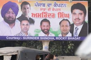 A poster with photos of Congress president Rahul Gandhi, Punjab CM Amarinder Singh and other party leaders in Amritsar.