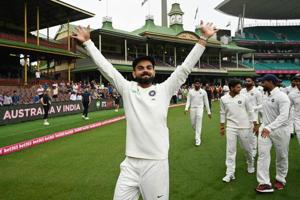 Indian players celebrate after their series win on the fifth day of the fourth and final Test against Australia.