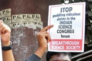People hold placards to protest against claims made by speakers, discrediting theories of Isaac Newton and Albert Einstein, at the 106th Indian Science Congress, in Kolkata on January 7.