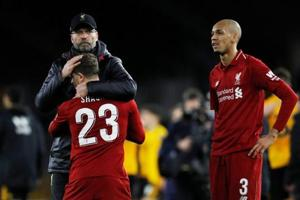 Liverpool manager Juergen Klopp, Xherdan Shaqiri and Fabinho react after the match against Wolves.