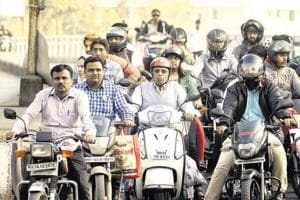 The traffic department claims that crackdown is proving to be a success. Here, most of the riders on Karve road are seen wearing helmets.