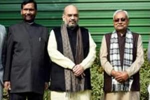 BJP President Amit Shah flanked by JD(U) Chief and Bihar Chief Minister Nitish Kumar (2nd R), Union minister and LJP President Ram Vilas Paswan (2nd L).