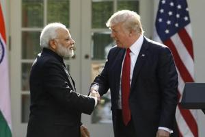 US President Donald Trump (R) greets Indian Prime Minister Narendra Modi during their joint news conference in the Rose Garden of the White House in Washington, U.S., June 26, 2017.
