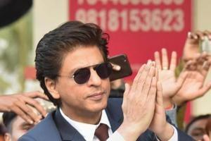 Shah Rukh Khan greets fans on his arrival for his movie promotion Zero, at Jai Prakash Narayan international airport, in Patna.