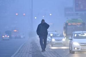 A man at Kirti Nagar on Monday morning.  Delhi's air quality was recorded to be 333, which was in the very poor category.