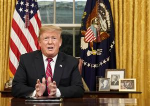 US President Donald Trump deliversa televised address to the nation from his desk in the Oval Office about immigration and the southern US border on the 18th day of a partial government shutdown at the White House in Washington, US.