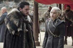 This image released by HBO shows Kit Harington, left, and Emilia Clarke on the season finale of Game of Thrones.