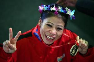 File: Indian boxer Mary Kom celebrates gold medal after winning the final match of women