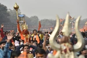 Supporters and members of Vishwa Hindu Parishad's (VHP) during 'Dharma Sabha' rally, in which thousands of people gathered to press for the construction of Ram Temple in Ayodhya, at Ramlila Ground, in New Delhi on December 9.