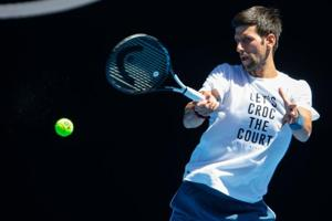 Novak Djokovic of Serbia plays a forehand shot during a practice session in Melbourne.