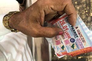 A buyer holding a Tuesday evening lottery ticket in Bara Bazaar, Kolkata.