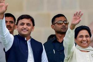 Samajwadi Party leader Akhilesh Yadav with Bahujan Samaj Party leader Mayawati wave at the crowd during the swearing-in ceremony of JD(S)-Congress coalition government, in Bengaluru.