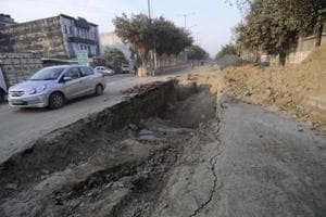 A road in Noida's Sector 67 that has been dug up just 20 days after it was resurfaced.