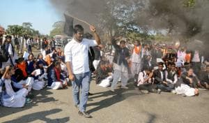 College students block a highway to protest against the Citizenship Amendment Bill in Assam's Dibrugarh on Saturday.