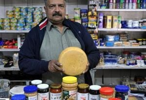 Anil Prakash at Prakash & Co, which was set up by his grandfather. In addition to their jams and jellies, they have cough drops, lozenges and even brollies. As the author and local resident Ruskin Bond once said, 'If you want something and Prakash's doesn't have it, you probably don't need it!'