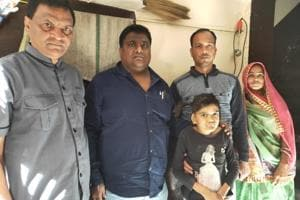 Devdutta Maji (second from left), president of Hindu group Singha Bahini, visited Shambhu Lal Regar's family at Rajsamand and gave a cheque for Rs one lakh to his wife Sita Regar.