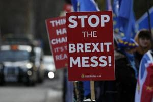 Pro-European demonstrators protest outside parliament in London, Friday, Jan. 11, 2019. Britain