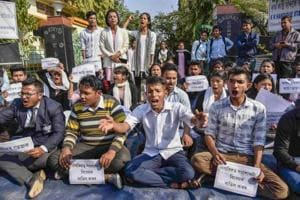 Guwahati Commerce College students stage a protest and raise slogans against Citizenship (Amendment) Bill, in Guwahati on Friday.