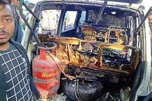 The van that caught fire in Bhadohi on Saturday.