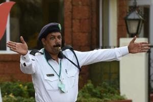 A policeman directs the traffic near a hotel in Goa on October 14, 2016.