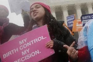 Margot Riphagen of New Orleans, La., wears a birth control pills costume during a protest in front of the U.S. Supreme Court in Washington.