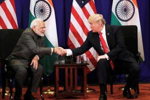 U.S. President Donald Trump shakes hands with India