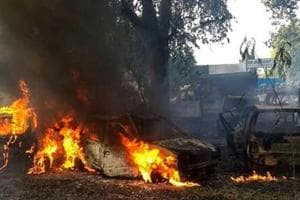 Vehicles set on fire by a mob during a protest over the alleged illegal slaughter of cattle, in Bulandshahr on December 3, 2018.