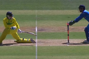 MS Dhoni pulls off a lightning-quick stumping to dismiss Peter Handscomb.