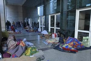 Patients wait outside the emergency wing, at Safdarjung Hospital, in New Delhi,  on Monday, January 14, 2019, following a flash strike by resident doctors.  The doctors called off their strike later on Monday evening.
