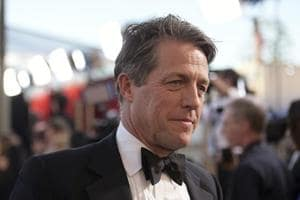 Hugh Grant arrives at the 23rd annual Screen Actors Guild Awards at the Shrine Auditorium & Expo Hall in Los Angeles.