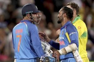 MS Dhoni (7) and Dinesh Karthik celebrate India's win over Australia.