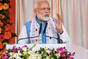 Prime Minister Narendra Modi addresses the gathering during the inauguration of various projects in Bolangir, Odisha, Tuesday, Jan 15, 2019.