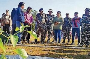 CRPF 197 battalion officers with farmers from villages in the Saranda forest region, West Singhbhum