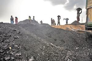 Laborers load a truck with coal at coal depot in Jaintia Hills, Meghalaya.